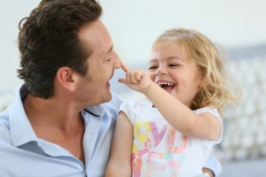 Daddy with little girl having fun together